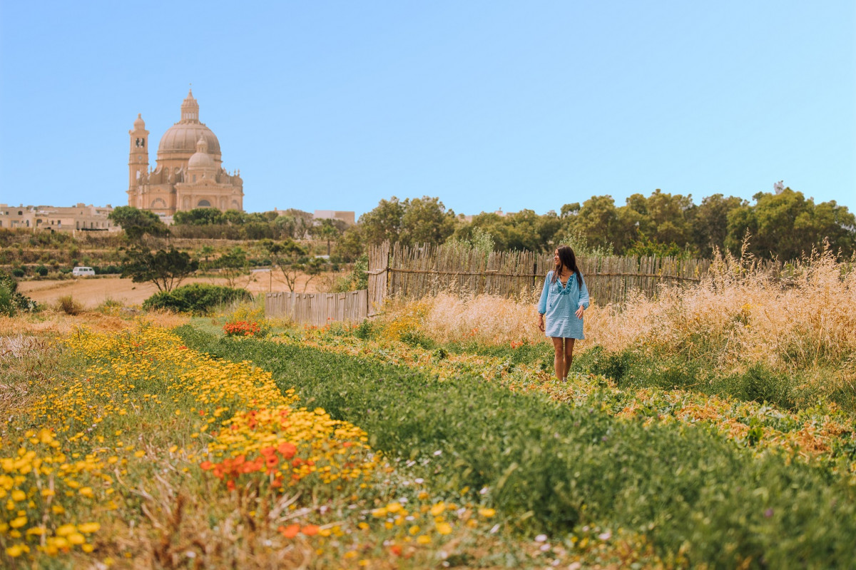 Gozo Woman in the fields by Ta' Pinu Church, Gozo